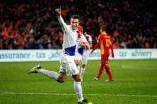 Robin van Persie scores twice in Dutch 4-0 win over Romania