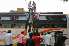 Thousands of Migrants Flee Gujarat after Reports of Attacks