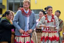Duchess Meghan Markle and Prince Harry Charm in Matching Skirts in Tonga