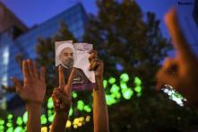 """Iranians revel as new president hails """"victory of moderation"""""""
