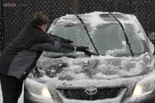 Sloppy weather slows US holiday travelers