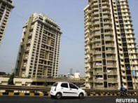 Woman survives ninth-floor fall