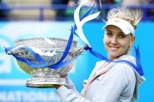 Vesnina overpowers Hampton to take Eastbourne title