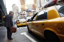 Three Britons travel round the world in a taxi