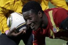 Ghana striker Gyan hurts ankle in training