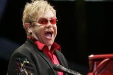 Elton John turns author, to pen stories about AIDS