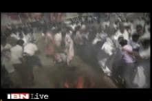 Watch: AIADMK worker's Veshti catches fire while he was burning effigies against DMDK