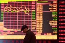 Asian Markets Tumble as Trump Tariffs Spark Trade War Fears