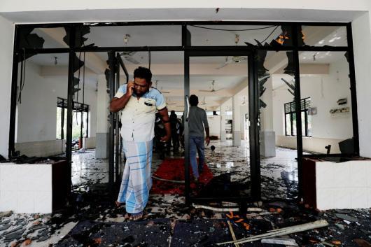 A Muslim man reacts inside the Abbraar Masjid mosque after a mob attack in Kiniyama, Sri Lanka. (Image: Reuters)
