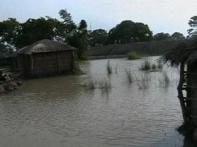 River breaks embankments, floods UP villages