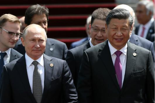 Russia's President Vladimir Putin and China's President Xi Jinping attend the SCO summit in Bishkek on Friday. (Reuters)