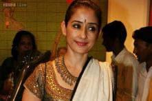 For which Southern film has Manisha Koirala postponed Rajkumar Santoshi's project?
