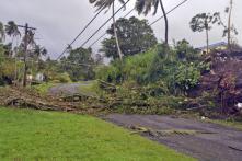 Tourists flee Fiji as cyclone toll hits 17