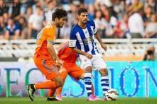 Valencia draw at Sociedad, slip to second in Spain
