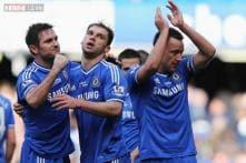 Leaders Chelsea grab late winner against Everton
