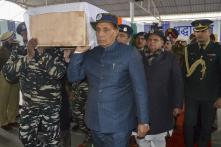 Rajnath Singh, J&K DGP Dilgabh Singh Carry Coffin of Soldier Killed in Pulwama Terror Strike​