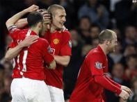 Manchester United beat Portsmouth, return to EPL summit