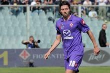 Milan sign midfielders Montolivo, Traore