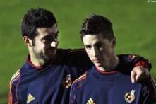 Spain's Albiol to undergo scans on injured knee