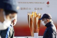 Olympic Flame Passed to Fukushima During Low-key Ceremony After Coronavirus Postpones Tokyo Games