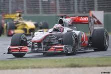 Button wins Australian GP, Vettel crashes