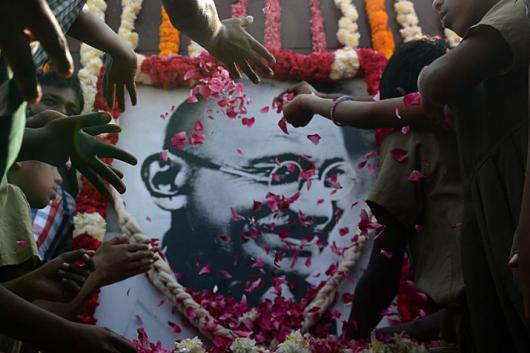 File photo of people paying homage to Mahatma Gandhi.