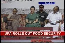 Sonia rolls out Food Security Scheme in Delhi, Thomas targets Modi