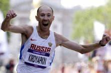 Russian Kirdyapkin wins gold in 50K race