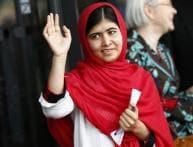 Malala meets Queen Elizabeth, regrets missing school