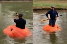 Watch: Farmer Turns 910-Pound Pumpkin into Boat and Goes for a Ride in Pond