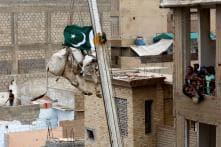 Karachi Man's Rooftop Cattle Get a Crane Lift to the Ground