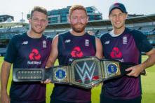 England Players Celebrate With Customized WWE Championship Belt