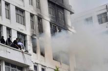 Day in Photos - November 5: Kolkata Park Street Fire; Sabarimala Reopening