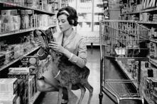 Snapshot: Hollywood actress Audrey Hepburn shopping with her pet deer 'Ip' in Beverly Hills in this stunning photo from 1958