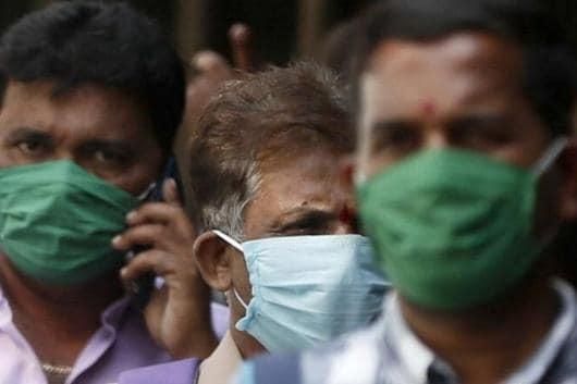 Men wearing protective masks walk inside the premises of a hospital in Mumbai. Representative Image. Reuters)