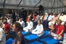 UN Secretary General Ban Ki-moon joins hundreds of yoga practitioners to perform asanas