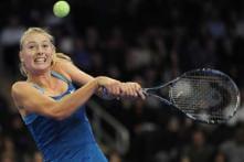 Sharapova beats Wozniacki in exhibition match