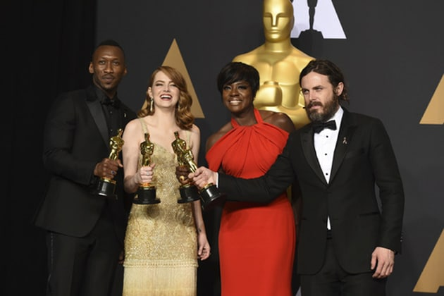 Mahershala Ali, winner of the award for best actor in a supporting role for Moonlight, from left, Emma Stone, winner of the award for best actress in a leading role for La La Land, Viola Davis, winner of the award for best actress in a supporting role for Fences, and Casey Affleck, winner of the award for best actor in a leading role for Manchester by the Sea, pose in the press room at the Oscars. Photo-AP