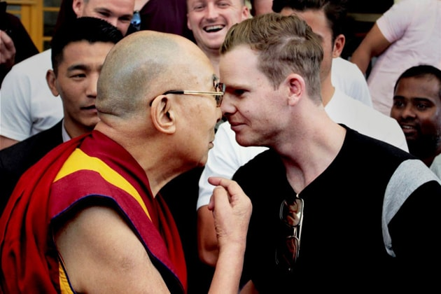 Tibetan spiritual leader The Dalai Lama meets Australian cricket team captain Steve Smith and his teammates on the eve of the last test match between India and Australia in Dharamshala on Friday. Photo: PTI