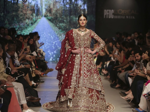 A model presents a creation of designer Nicke Nina during the Bridal Fashion Week organized by the Pakistan Fashion Design Council, in Lahore, Pakistan. Photo: AP