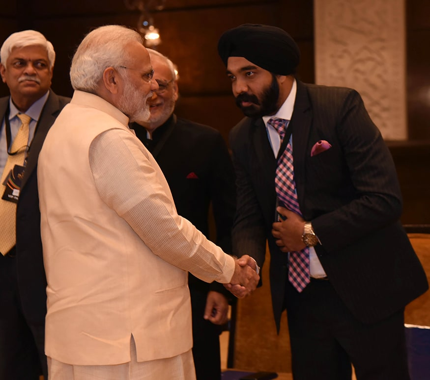 Airbnb India's Country Manager, Amanpreet Bajaj greets Prime Minister Narendra Modi at the summit (Photo: News18)