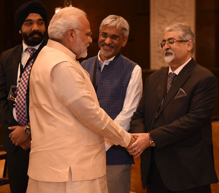 Corporate lawyer Shardul Shroff shakes hands with PM Modi at the News18 Rising India Summit (Photo: News18)