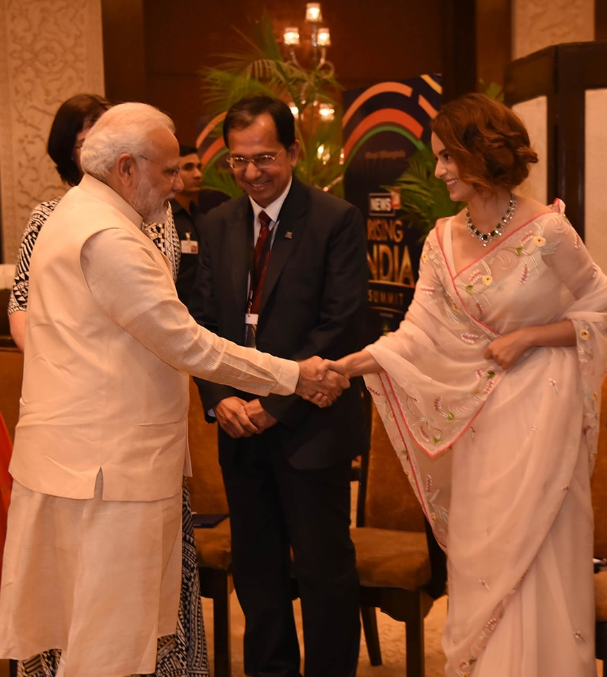 Bollywood actress Kangana Ranaut shakes hands with PM Narendra Modi at the summit (Photo: News18)
