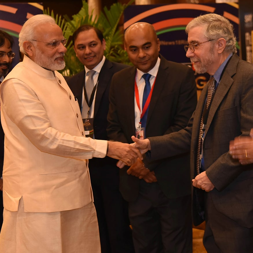 American economist and Nobel laureate Paul Krugman and PM Narendra Modi are seen exchanging greetings at News18 Rising India Summit (Photo: News18)
