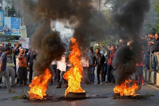 College students burn tyres at a protest against the Citizenship Amendment Bill in Guwahati on Wednesday. (PTI)