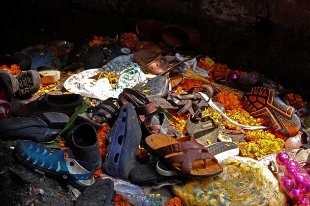 Footwear of the victims of a stampede are seen below a railway station's pedestrian overbridge in Mumbai