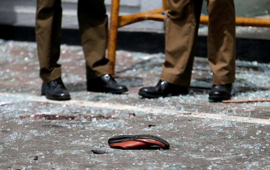 தேவாலத்திற்கு வெளியே சிதறி கிடக்கும் கண்ணாடிகள் (Image: Reuters)