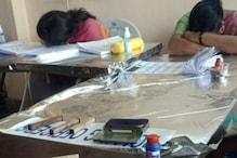 GHMC Elections 2020: ఓటర్లు లేక పోలింగ్ కేంద్రంలో నిద్రపోతున్నారు.. ఫొటో ఆఫ్ ద డే