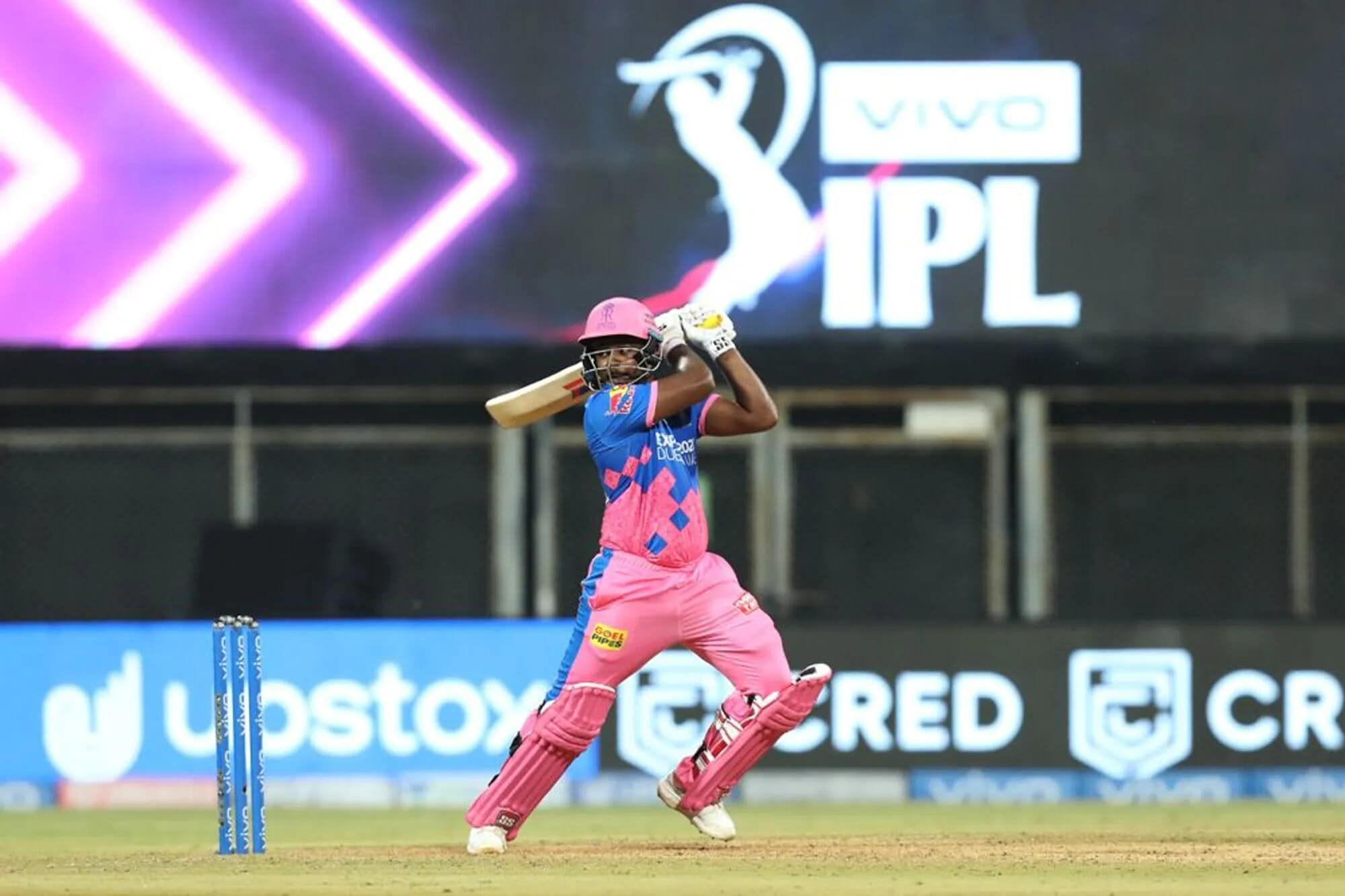 Sanju Samson did what he does best in the IPL – start the tournament with a blistering hundred! Despite losing two early wickets in a mammoth 222-run chase, Samson kept the hope and belief of the Royals alive initially taking his time to resurrect the innings before going on the offensive after the dismissal of Jos Buttler.